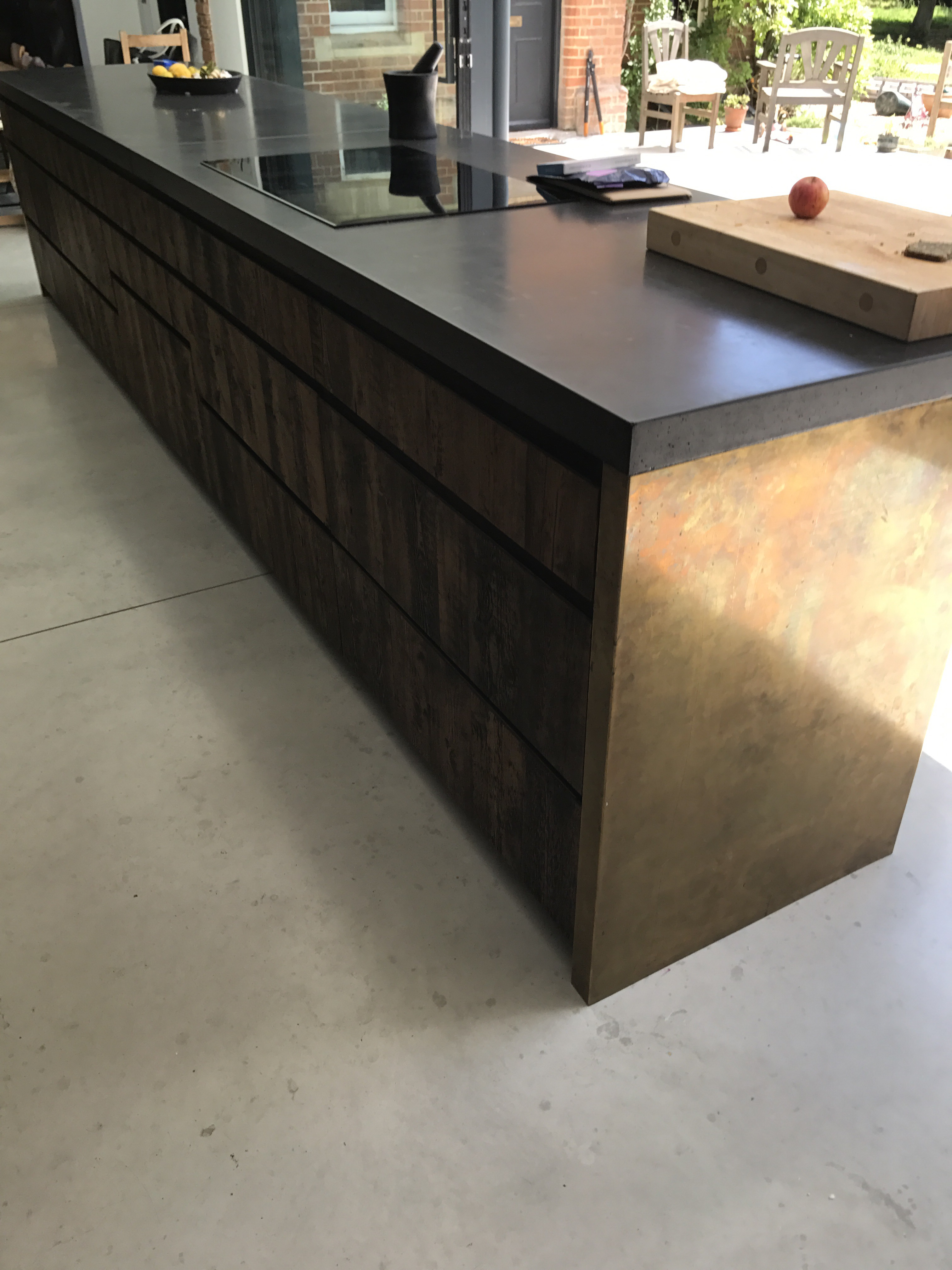 Our Aged Brass kitchen island with Black Polished concrete